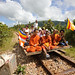 Monks on Cambodian Bamboo Railway Car