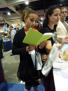 A fan reads Natalia Hernandez's The Cat Eyes - Fantagraphics at Comic-Con 2010 | by fantagraphics