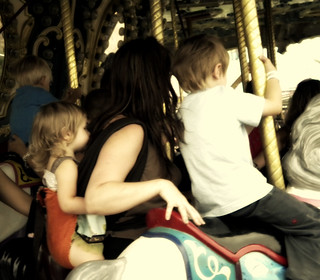 babywearing on the merry go round | by Stephanie Precourt