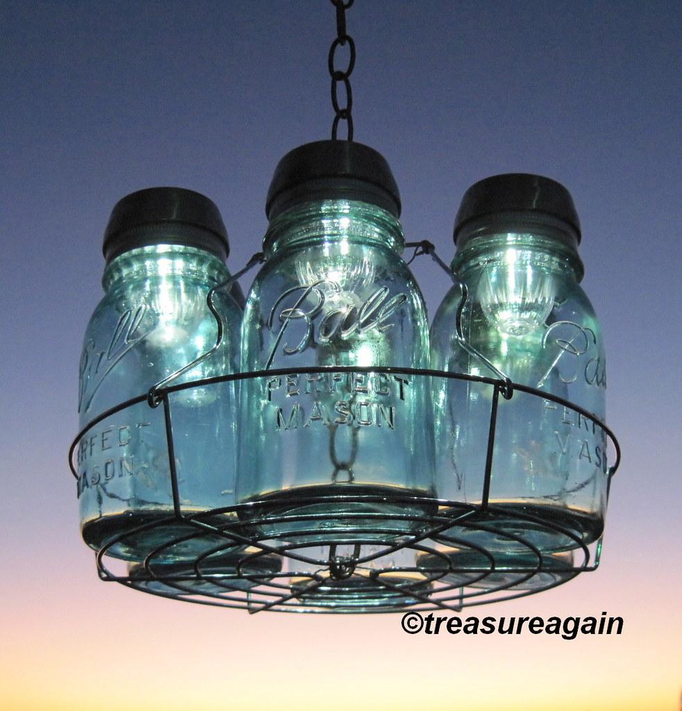 6 mason jar solar lights chandelier by treasureagain flickr 6 mason jar solar lights chandelier by treasureagain by treasureagain arubaitofo Choice Image