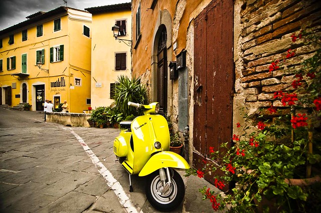 Lari, Toscany. Vespa parked in front of a house
