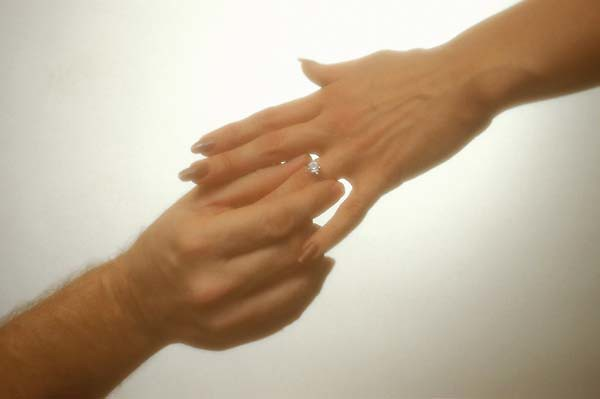 Novastock5721 Man Places Engagement Ring On Woman 39 S Hand