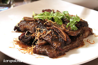 Beef ribs, slow-braised in young coconut water | by keropokman
