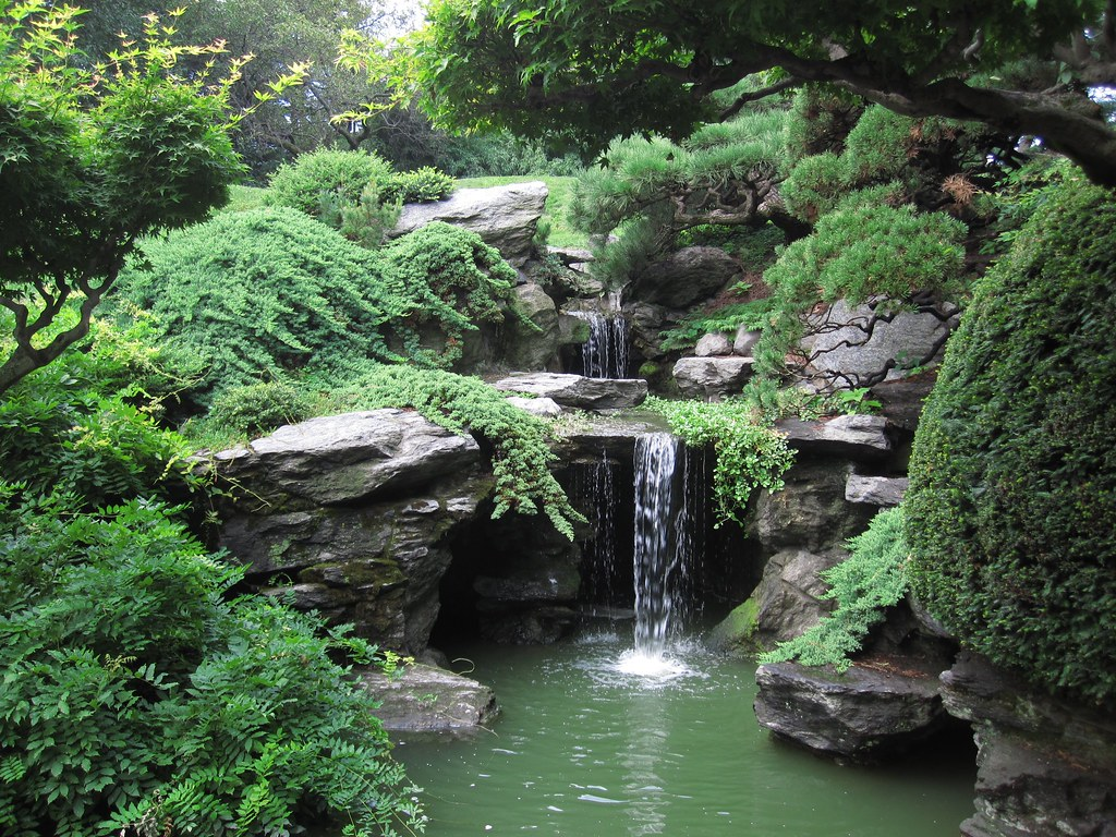 Japanese garden the waterfall in the japanese hill and for Small japanese water garden