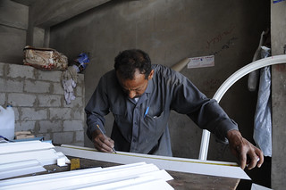 Co-owner in aluminum shop that makes window frames | by World Bank Photo Collection