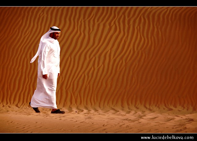Kuwait - Life, Shapes and Shadows of Kuwaiti Desert - Kuwaiti Man Walking through Large Sand Dunes