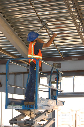 Installing fire sprinkler systems a workman installs the