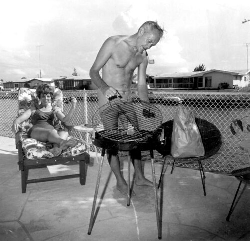 Couple outside with their grill: Cocoa Beach, Florida | by State Library and Archives of Florida
