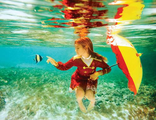 Beautiful Blonde Girl In White Bikini Is Swimming Underwater ...