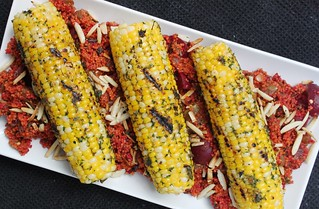 Sofrito Crusted Corn on the Cob over Red Couscous | by Zsu Dever