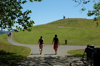 Two people walking onto the post industrial Gasworks park, clear and sunny, with a kite flying, Seattle, Washington, USA | by Wonderlane