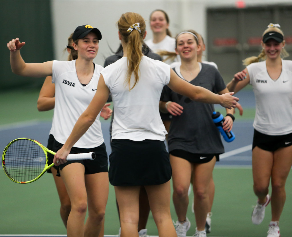 The University of Iowa Tennis team celebrating