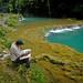 Around Coban 25 - Man reading the paper at Semuc Champey