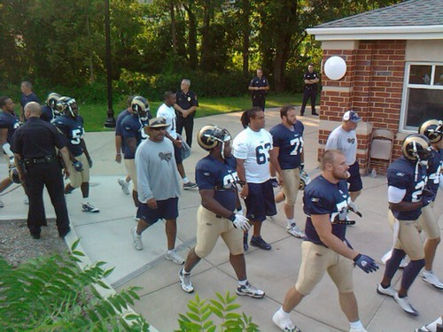 Chris Long leads a group of Rams onto Lindenwood field | by RamsHerd.com