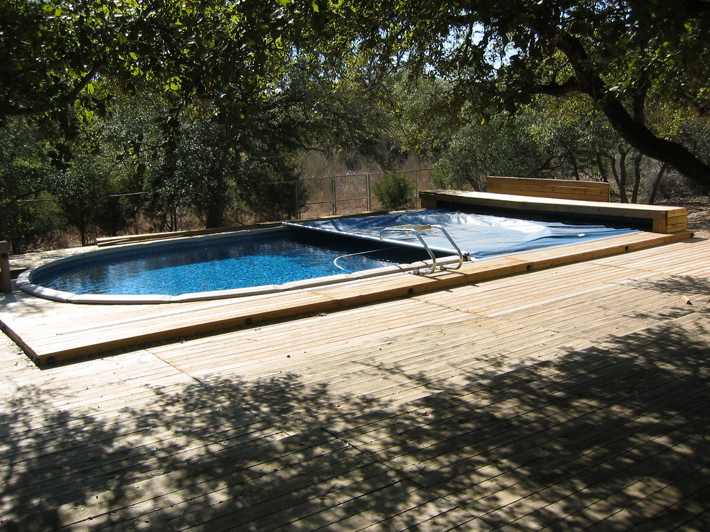 Above ground retractable pool cover bulverde tx flickr for Retractable swimming pool covers