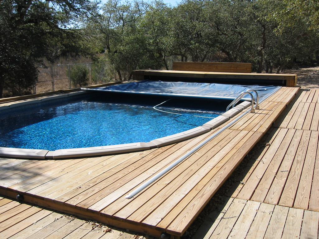 Above ground retractable pool cover bulverde tx flickr - Covering a swimming pool with decking ...