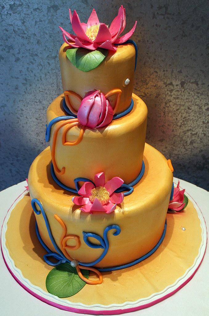 Red Lotus Cake Design : Electric Lotus Tiered wedding cake with a lotus design ...