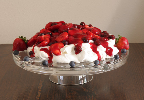 berry pavlova on stand | by Madison Bistro
