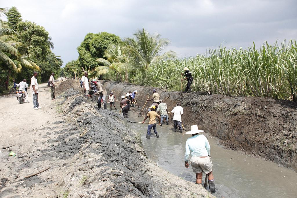 Help For Haiti >> Clearing drainage canals, near Leogane, Haiti | Haitian men … | Flickr