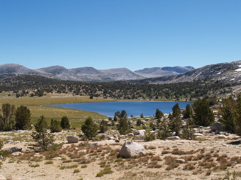 Looking east over Evelyn Lake, with the Kuna Crest in the background, and Kuna Peak on the far right