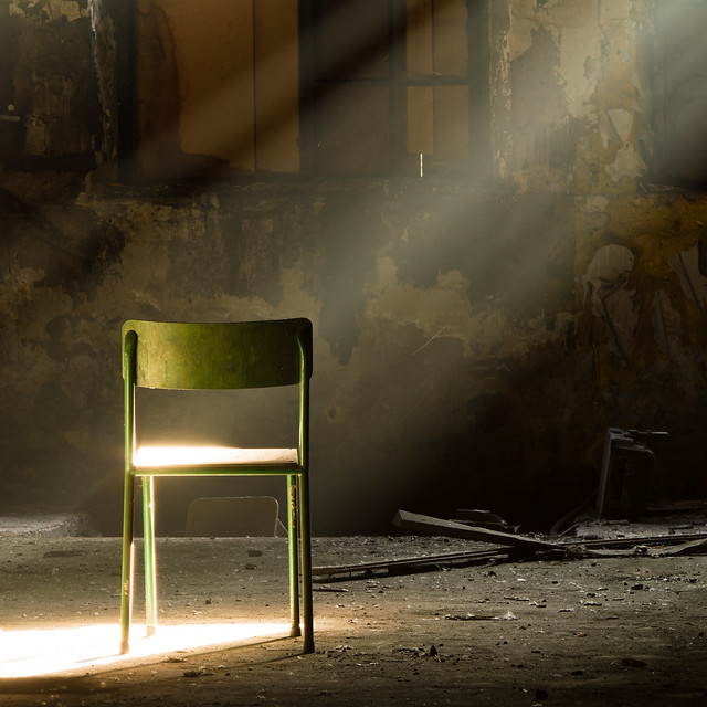 a lone green chair