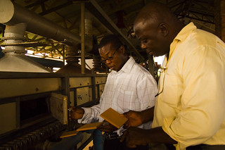 Two men inspect the quality of tile being produced in factory | by World Bank Photo Collection