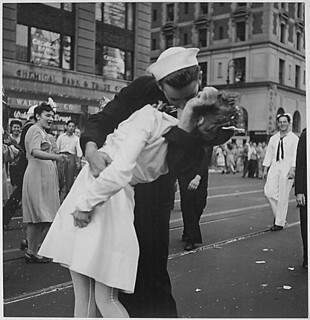 New York City celebrating the surrender of Japan. They threw anything and kissed anybody in Times Square., 08/14/1945 | by The U.S. National Archives