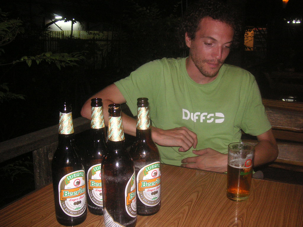 Drinking in a garden bar in Vientiane. It looks like I'm about to vom, but I'm actually having a bloody good time!