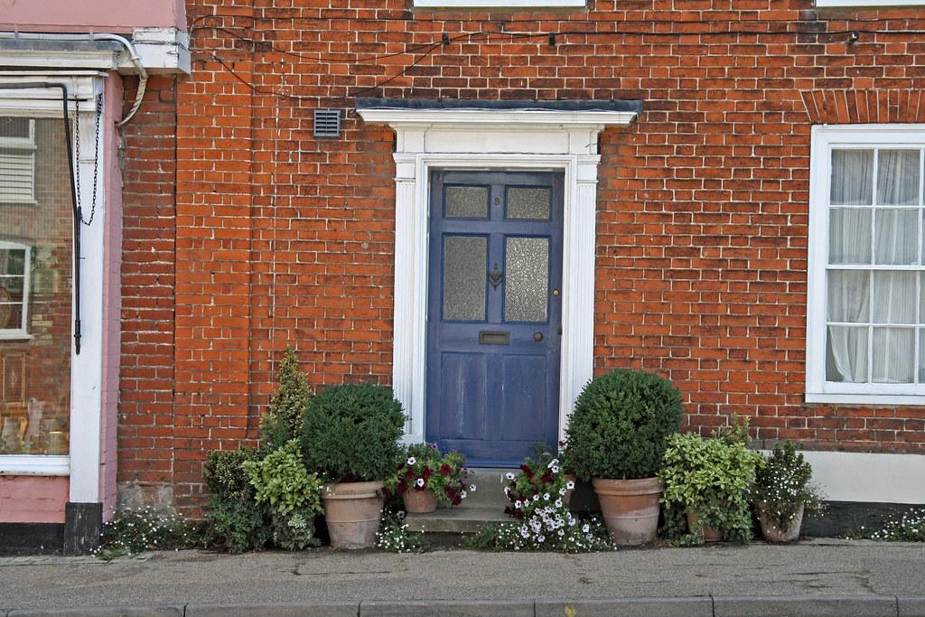 Blue door brick house blue wooden door in a red brick - House with blue door ...