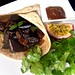 Chapatti wrap of pickled eggplant Sicilian style with fresh mint and coriander leaves served with a maracuja, chocolate, fried onions dip sauce