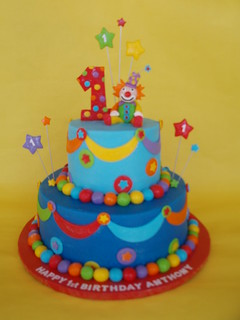 Colorful Clown First Birthday cake | by CakesUniqueByAmy.com