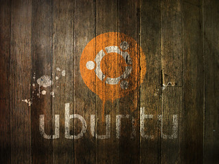old painted Ubuntu logo on wood planks | by blumblaum