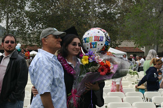 Graduates with family and friends after ceremony | by California State University Channel Islands