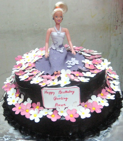 Barbie Chocolate Cake Images : Barbie on flower bed over 2 Tier chocolate cake Order ...
