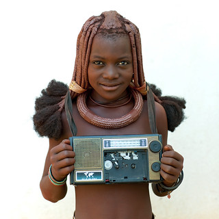 Himba girl with her radio - Angola | by Eric Lafforgue