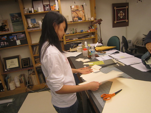 Bei Li making 4-flap enclosures | by craig.fansler