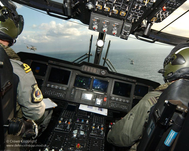 Two Dutch Naval Lynx Helicopters Pictured From Cockpit Of