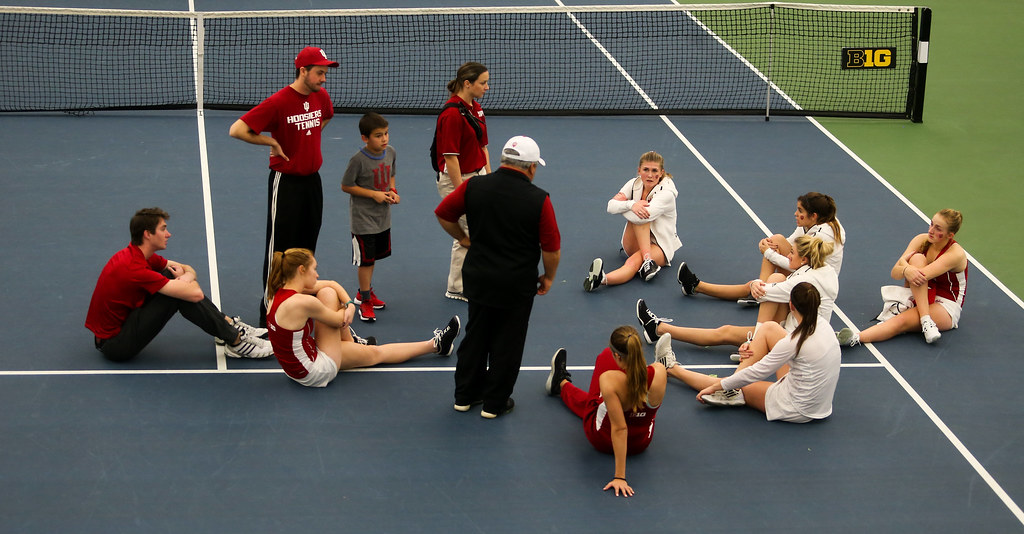 Indiana University's head coach Ramiro Azcui talks with the Hoosiers after their defeat against the University of Iowa Hawkeyes.