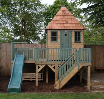 wooden playhouse on platform with slide project code pc