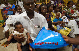 Families receiving malaria bed nets | by World Bank Photo Collection