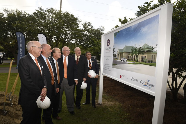 Dr. Leath and others look at a rendering of the educational complex.