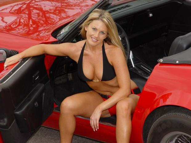 hot naked chick sitting in a cool car