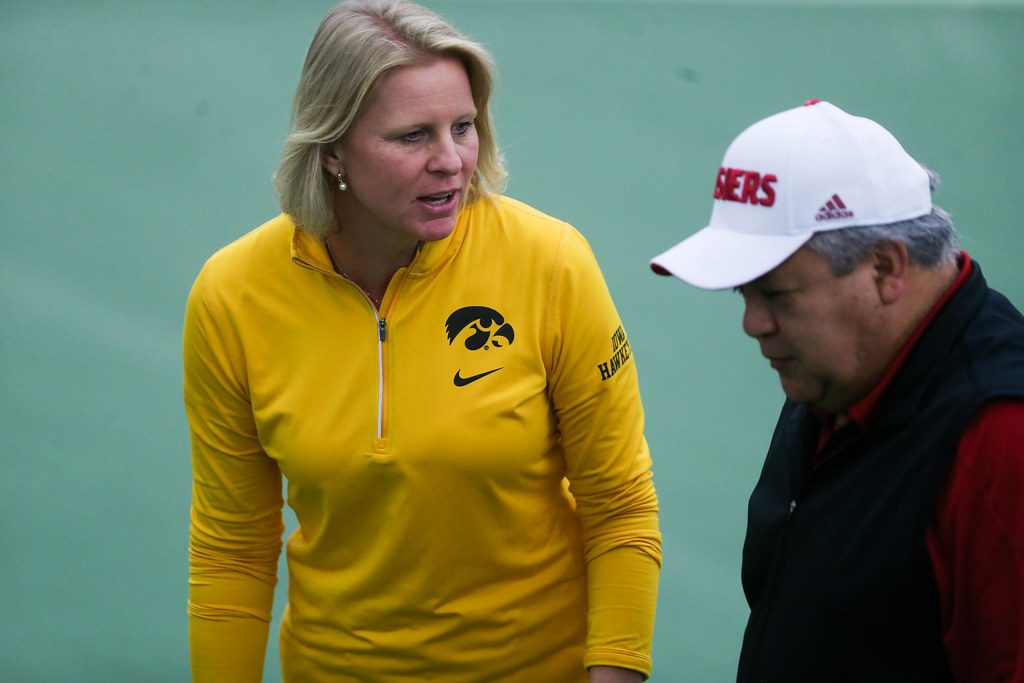 Indiana University's head coach talk with Iowa's head coach Sasha Schmid.