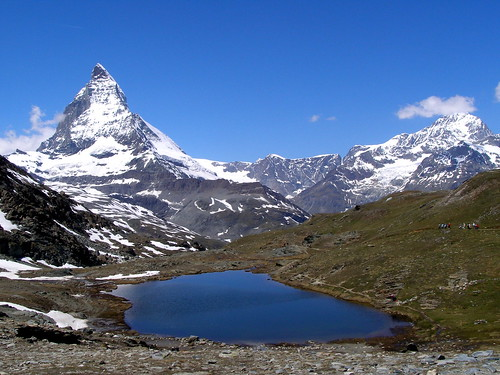 Hiking at 3000 m. high near a small  lake at  the foot of the Matterhorn Swiss | by nilliske