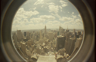 a fisheye view of manhattan from the rockefeller building | by fairminer