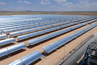 Rows of solar panel at a thermo-solar power plant | by World Bank Photo Collection