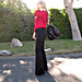 black flaired trousers+vintage red blouse+ferragamo bag+gold accessories+pf
