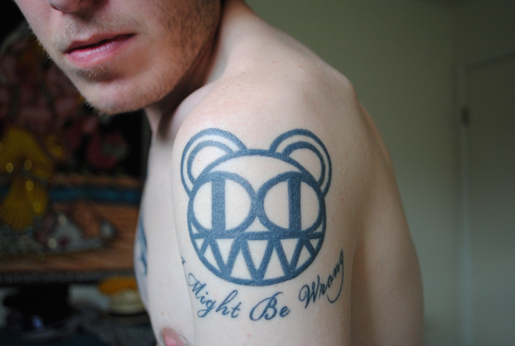 i might be wrong tattoo of the radiohead bear logo with