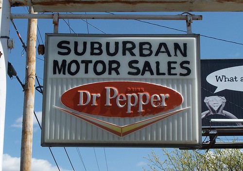 oh lima suburban motor sales dr pepper sign for
