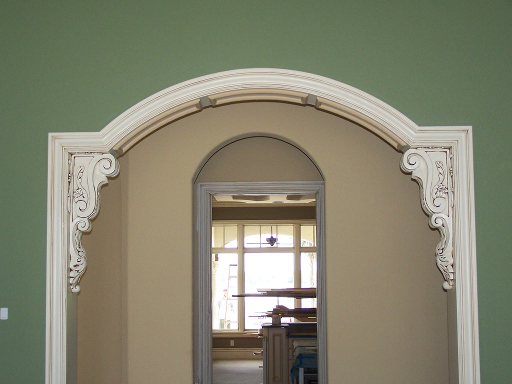 Detailed trim on arched doorway plus corbels for Decorative archway mouldings